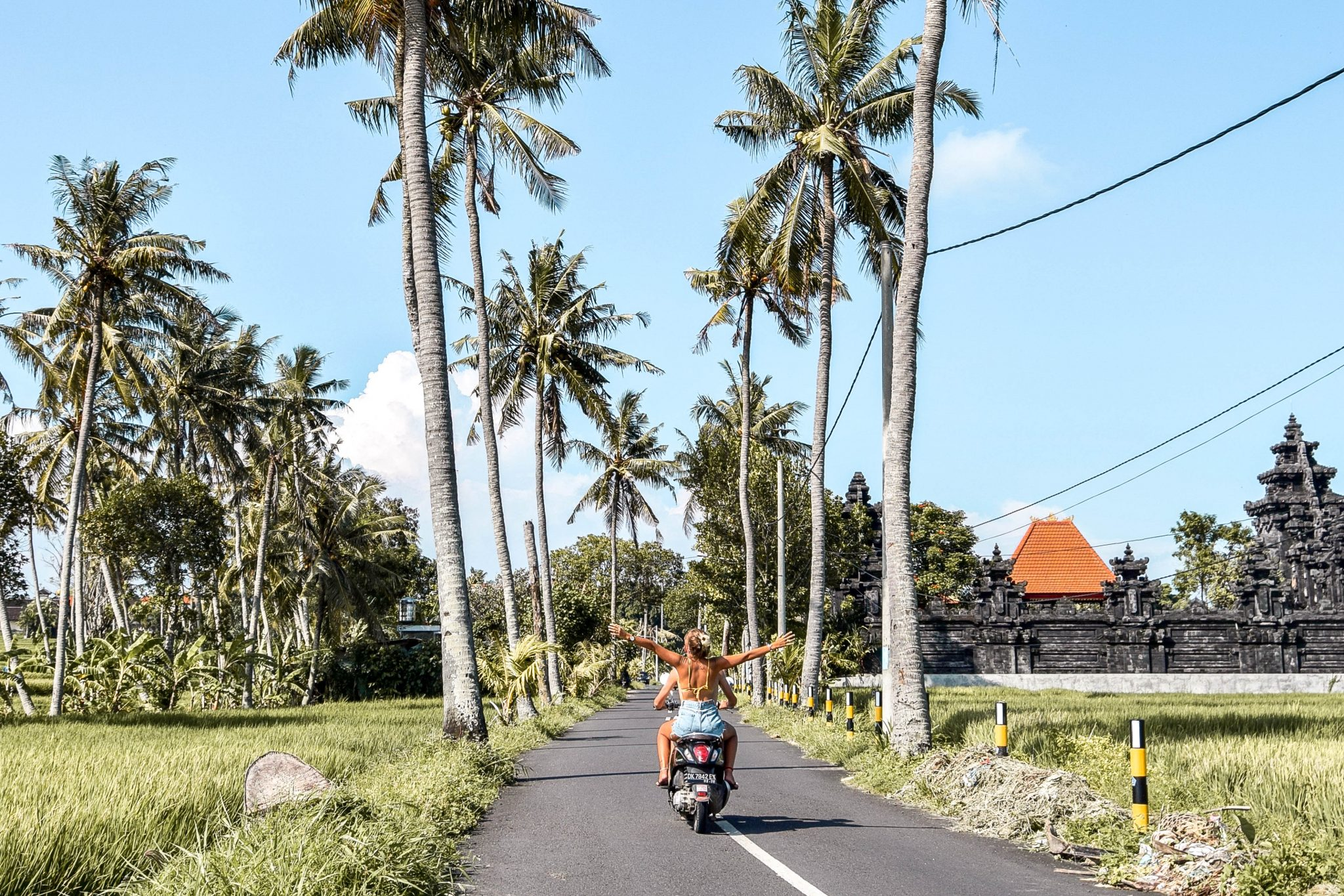 Wanderers & Warriors - Charlie & Lauren UK Travel Couple - 13 Things To Do In Canggu Bali - Scooter Canggu Bali