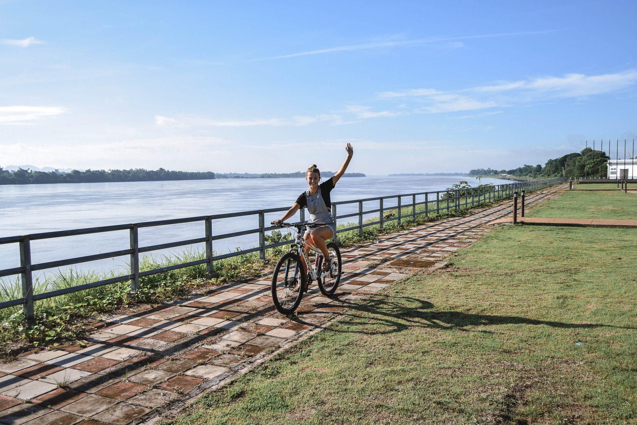 Wanderers & Warriors - Charlie & Lauren UK Travel Couple - 7 Things To Do In Nakhon Phanom - Mekong River Bike Ride