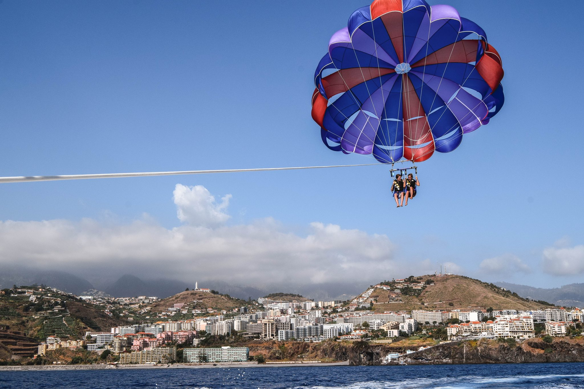 Wanderers & Warriors - Charlie & Lauren UK Travel Couple - Things To Do In Funchal Things To Do - Parasailing Funchal Madeira